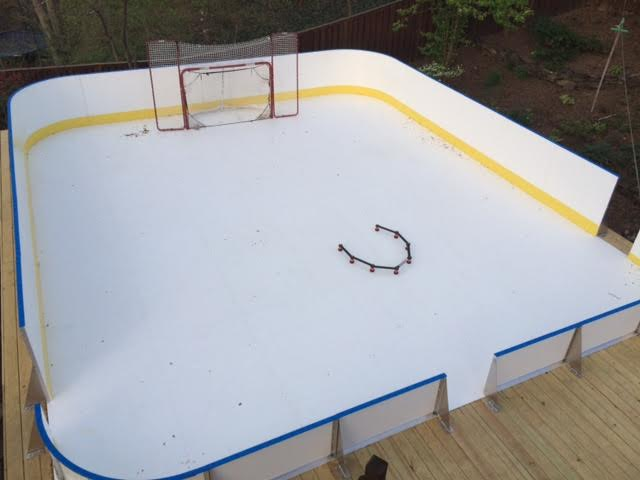 Superb 28u2032 X 32u2032 Synthetic Rink Mix Of Tall/Short Boards Installed On Wood Deck